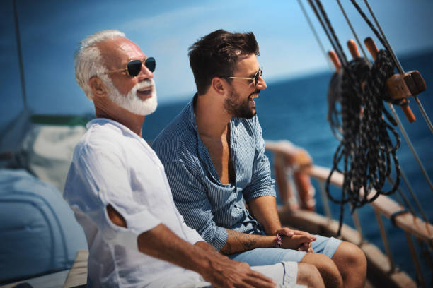 Father and son sailing. stock photo