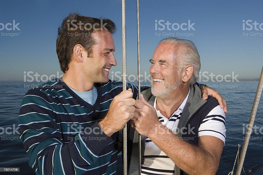 Pai e filho de Vela foto de stock royalty-free