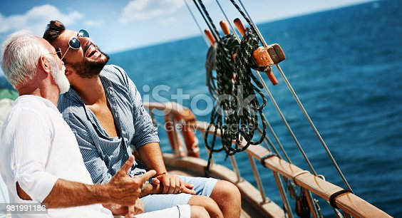 istock Father and son sailing. 981991186