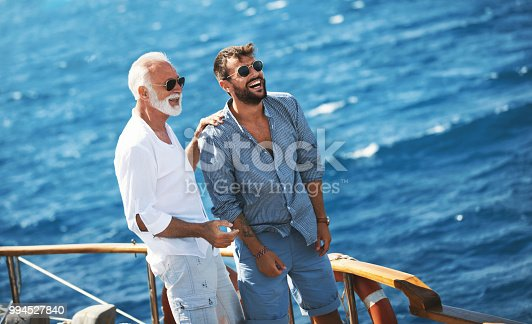 istock Father and son sailing. 994527840