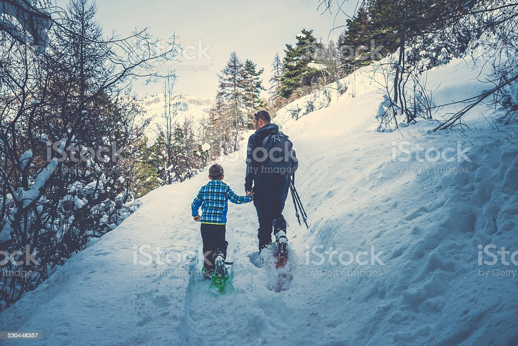 Father and Son Snowshoeing stock photo