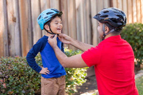 Father and Son Sports Safety - foto stock