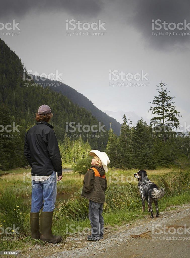 Father and son standing on the side or dirt road royaltyfri bildbanksbilder