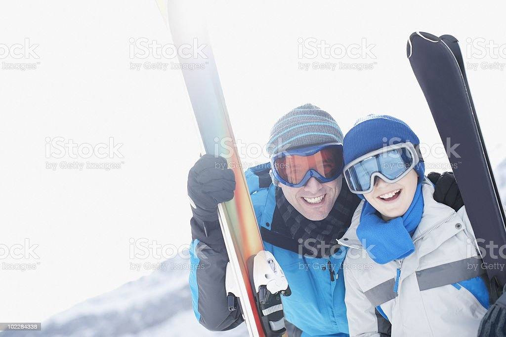 Father and son standing with skis royalty-free stock photo