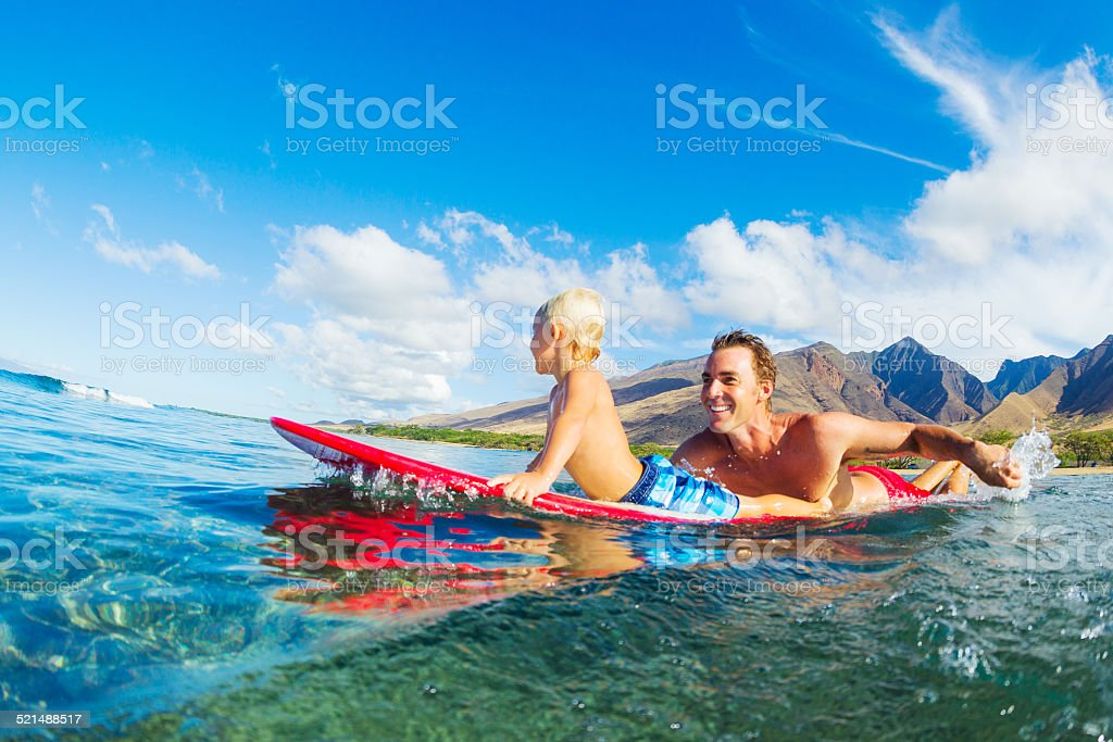 Father and Son Surfing stock photo