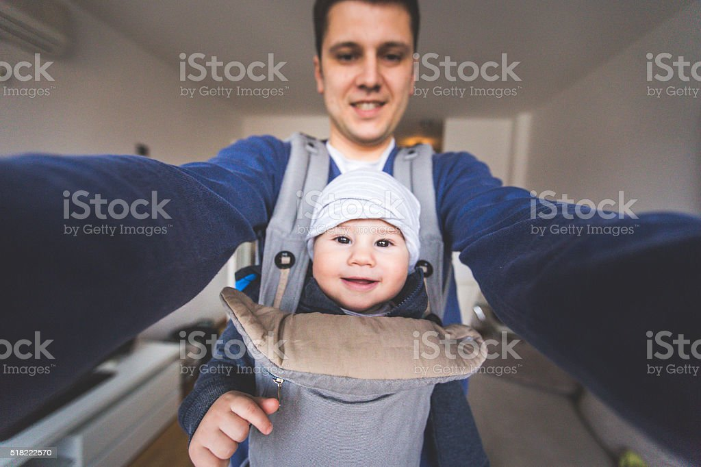 Father and son taking a selfie stock photo