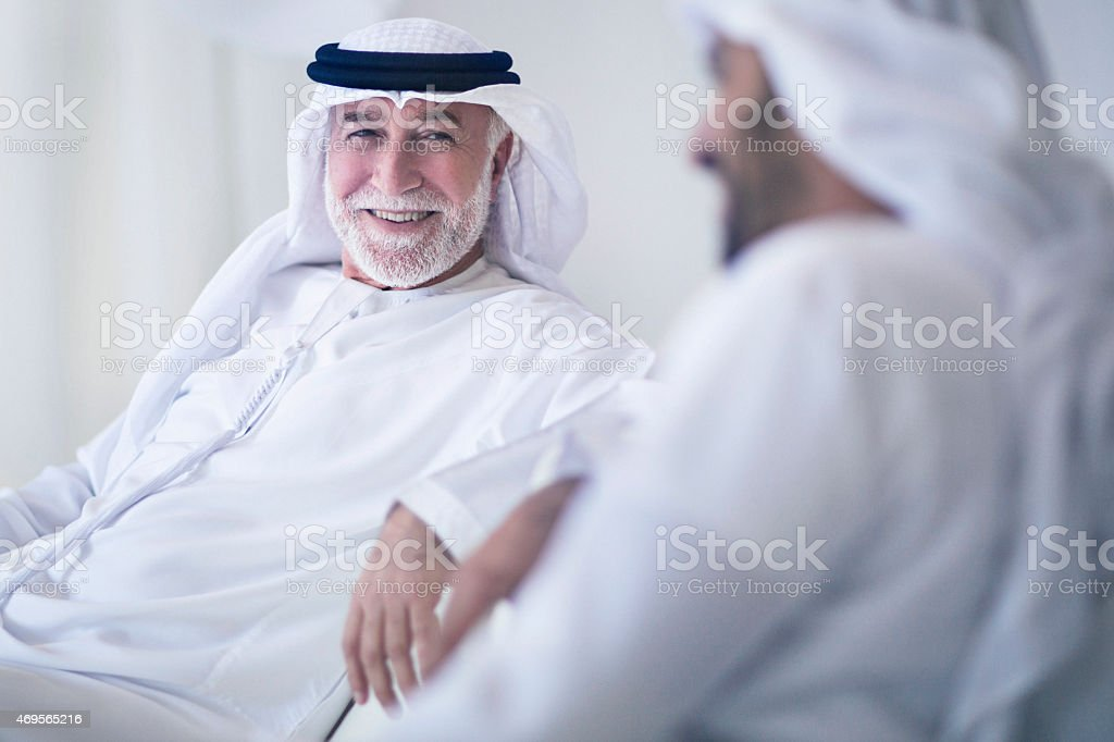Father and son talking stock photo