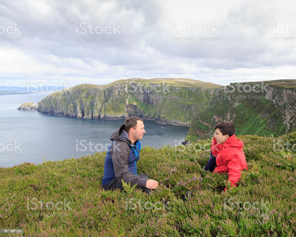 Father and son talking. stock photo