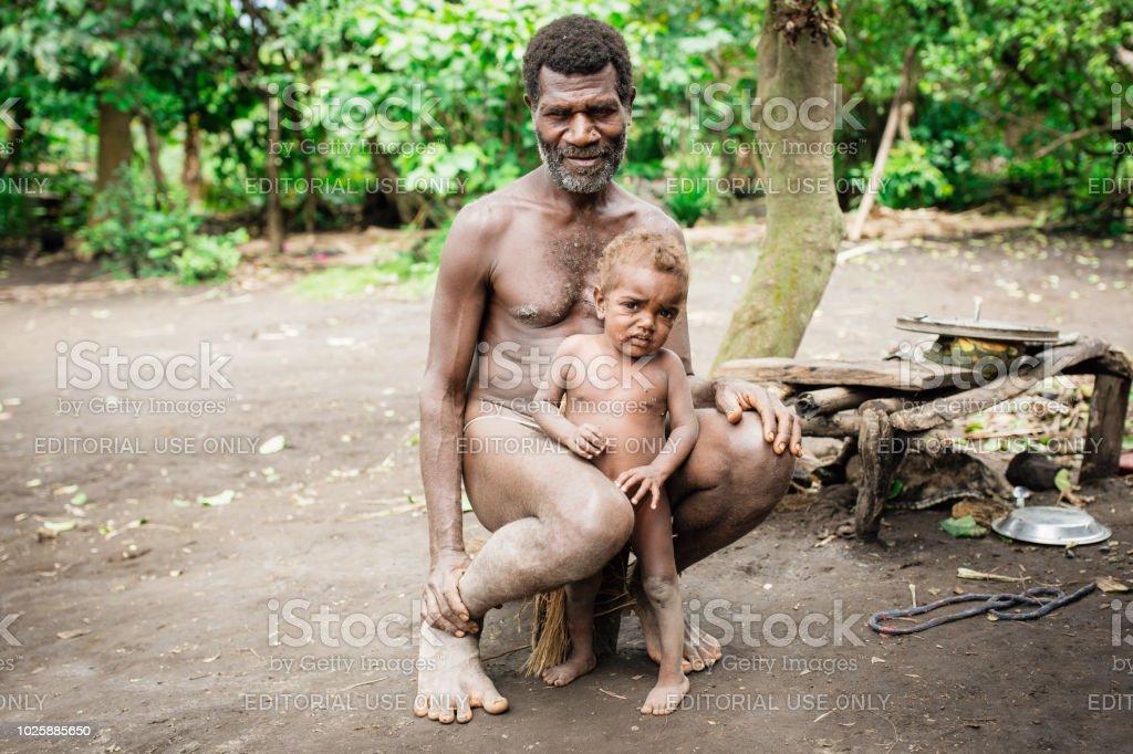 Father and Son Tanna Island Tribe Kastom Village Vanuatu stock photo