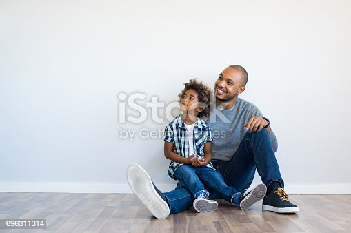 istock Father and son thinking 696311314