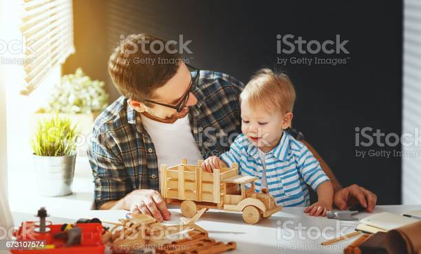 Father and son toddler gather craft a car out of wood and play picture id673107574?b=1&k=6&m=673107574&s=612x612&h=croz8cys9bwdtbidns4s5kxwrr8pfrq5mgacn4rsvli=