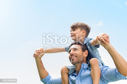 istock Father and son together 528286906