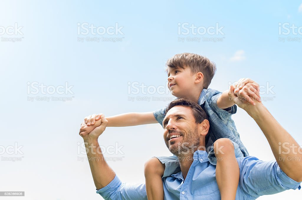 Father and son together stock photo