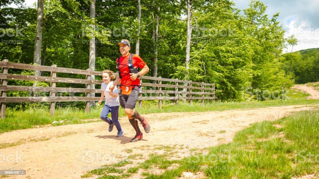 the best attitude a1e9d 0759f Father And Son Trail Running - Fotografie stock e altre ...