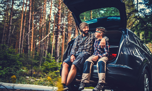 Father and son travelling by car in the forest. Gettyimages creative brief content: 69359735