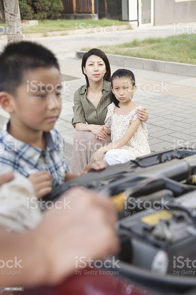 Father and Son Try to Fix the Car royalty-free stock photo