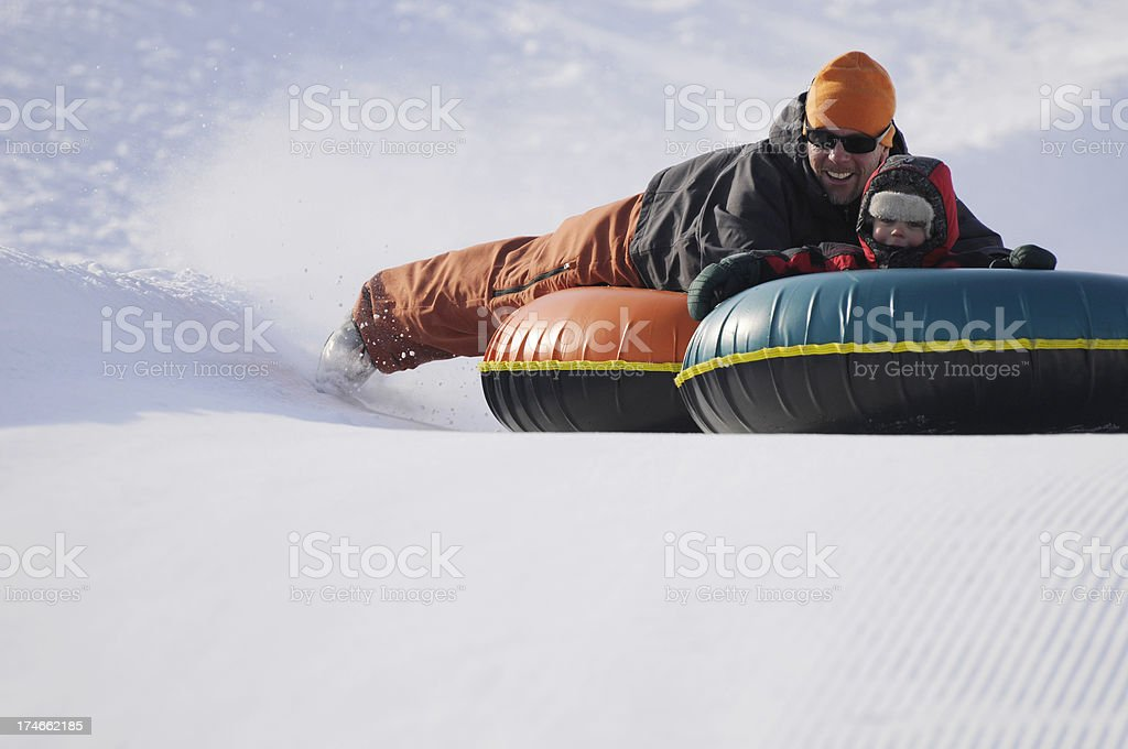 Father and Son Tubing royalty-free stock photo