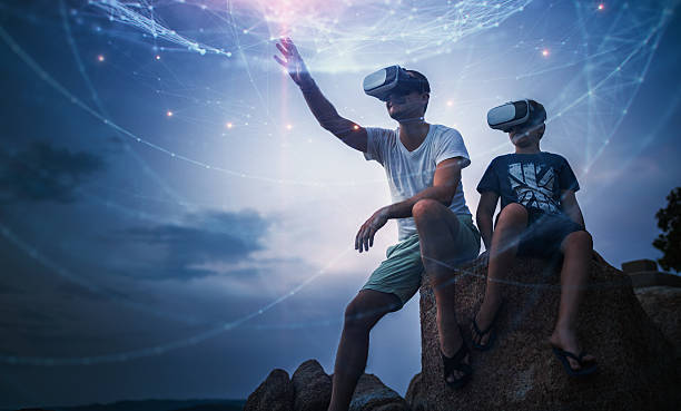 father and son using virtual reality glasses sitting outside - hologram stock photos and pictures