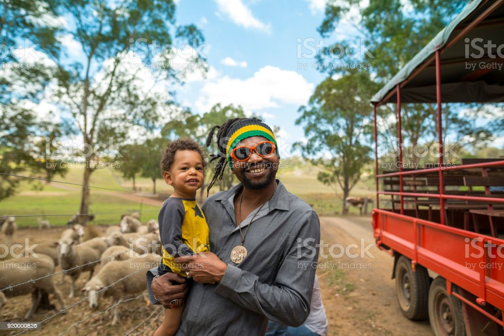 Father and son visited an organic farm stock photo
