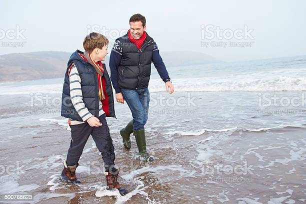 Father and son walking on winter beach picture id500768623?b=1&k=6&m=500768623&s=612x612&h=mxw2yzdzc9vsag4sqciotcuyeenikl48oafgm725sve=
