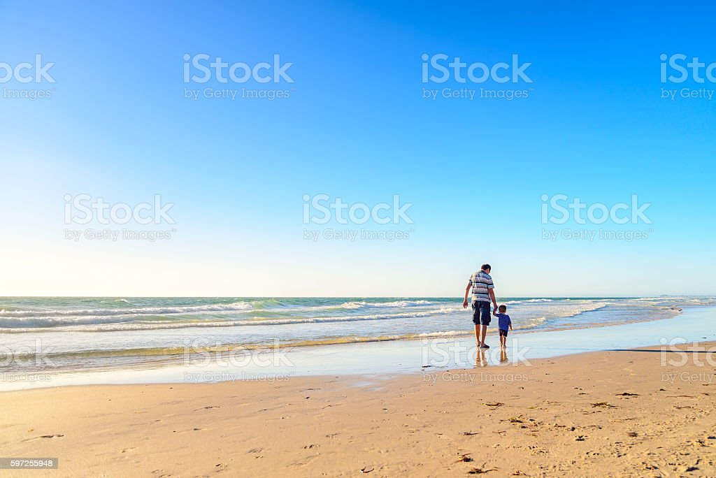 Father and Son Walking Together Holding Hands stok fotoğrafı