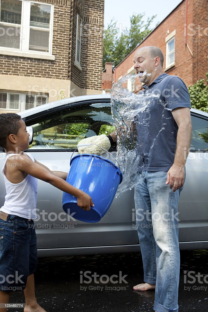 Father and Son Washing Car Water Fight SPLASH stock photo