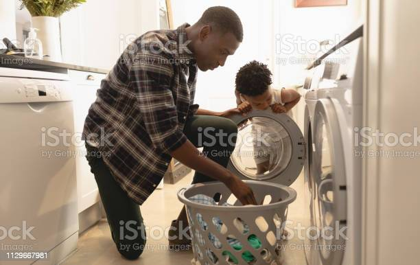 Father and son washing clothes in washing machine picture id1129667981?b=1&k=6&m=1129667981&s=612x612&h=0qbsza9dqctwj3ab7nmoee0ixehvrrfwcly6b6eodvu=