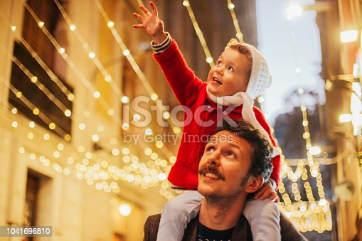 Father and son watching the Christmas lights