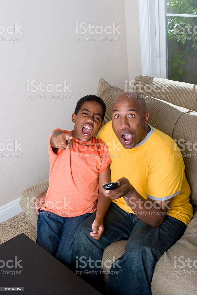 Father and son watching TV royalty-free stock photo