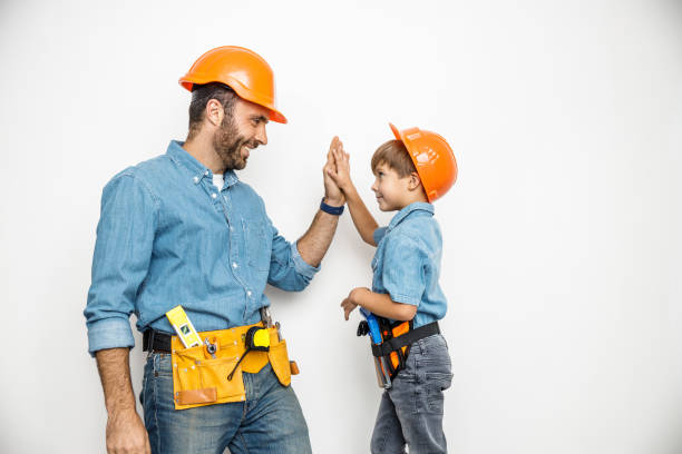 Father and son with building tools stock photo stock photo