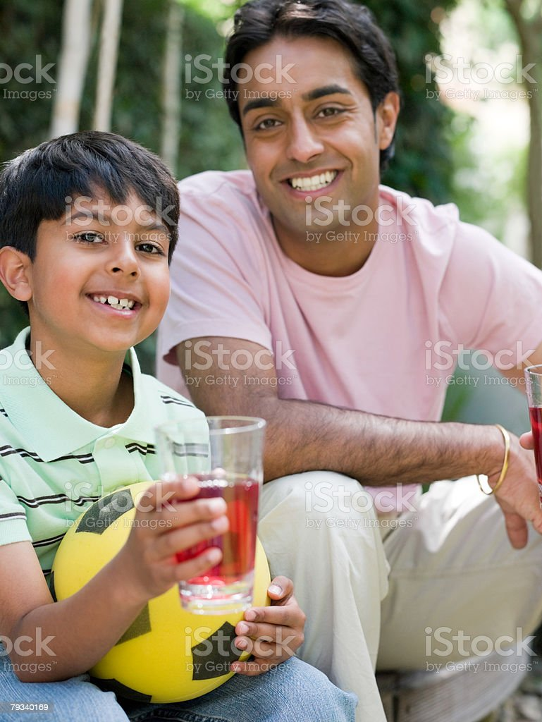 Father and son with drinks 免版稅 stock photo