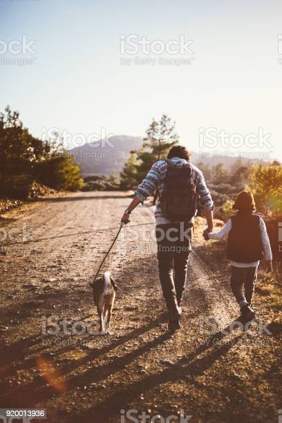 Father and son with family dog hiking on mountains picture id920013936?b=1&k=6&m=920013936&s=612x612&h=zabi1uy l5j3w6eqi xaw0k2r1f42kesktsm dd3vxi=