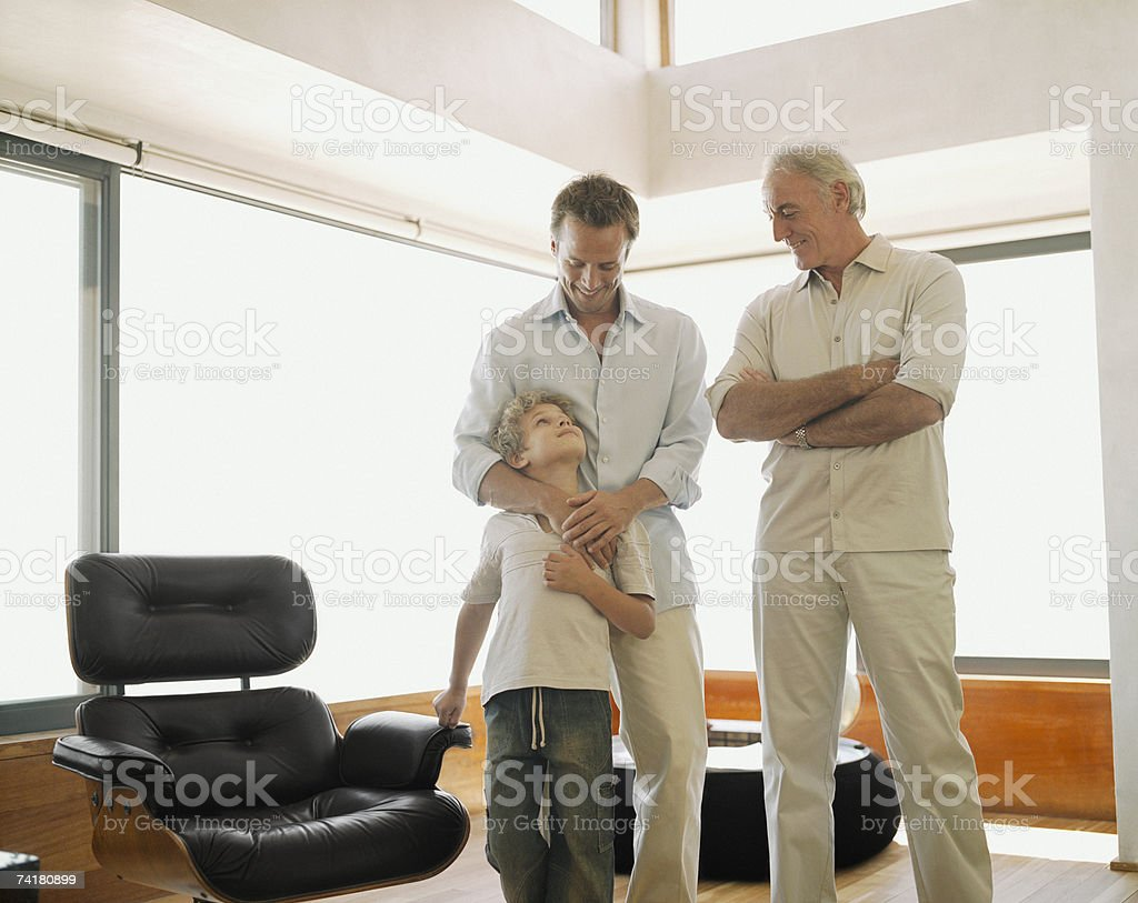 Father and son with grandson royalty-free stock photo