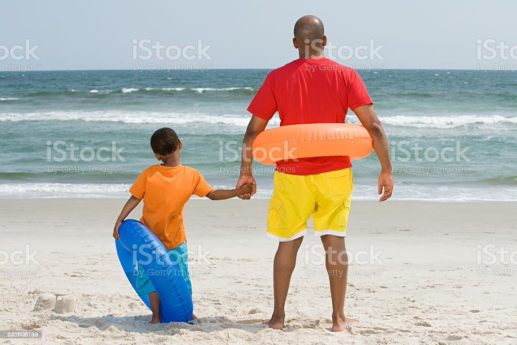 Father and son with inflatable rings stock photo
