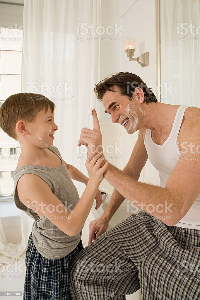 Father and son with shaving cream royalty-free stock photo