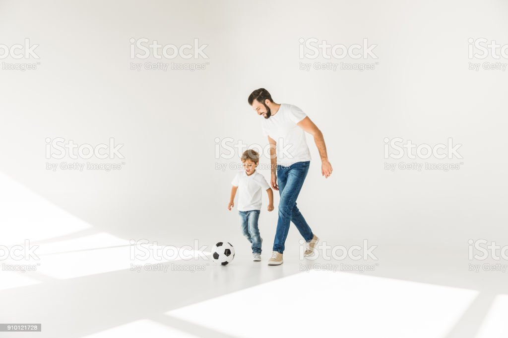 father and son with soccer ball stock photo