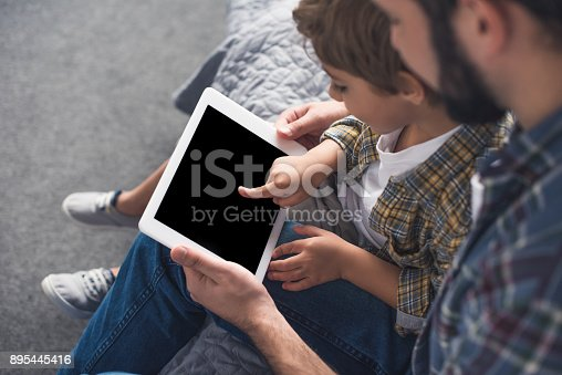 istock father and son with tablet 895445416