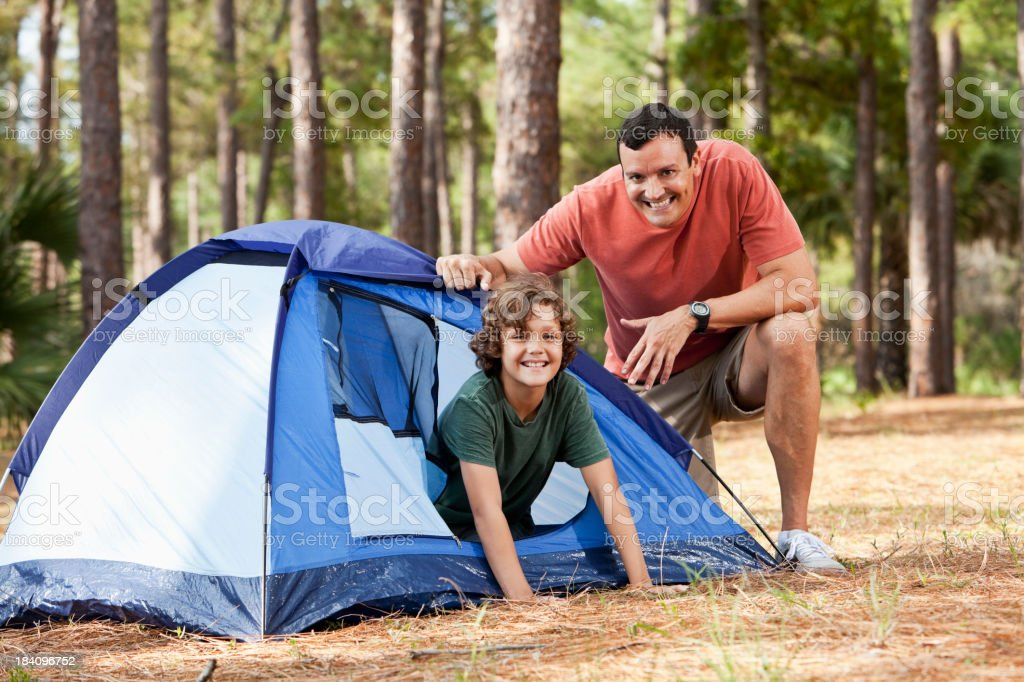 Father and son with tent on camping trip royalty-free stock photo