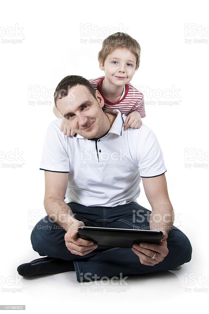 Father and son with the computer. stock photo