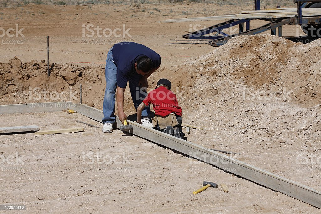 Father and Son Working on a Construction Project royalty-free stock photo