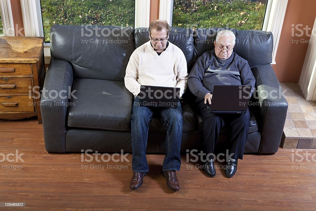 Father and Son working on Laptop royalty-free stock photo