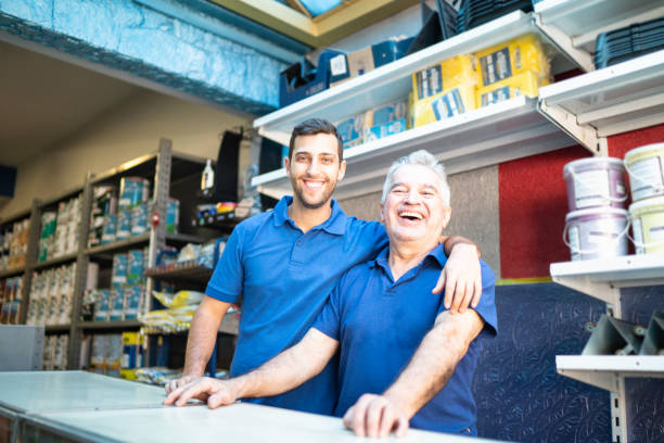 father and son working together in a paint store - small business owner stock pictures, royalty-free photos & images
