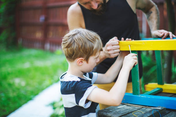 Father and son working together stock photo