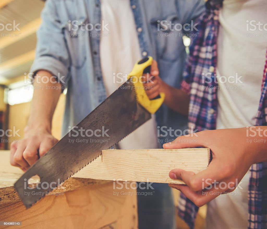 Father and son working with wood stock photo