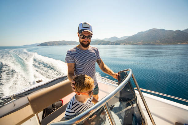 Father and son yachting stock photo
