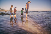 Family enjoying a beautiful sunset in the tide pools of Santa Barbara, father and son spend quality time together.