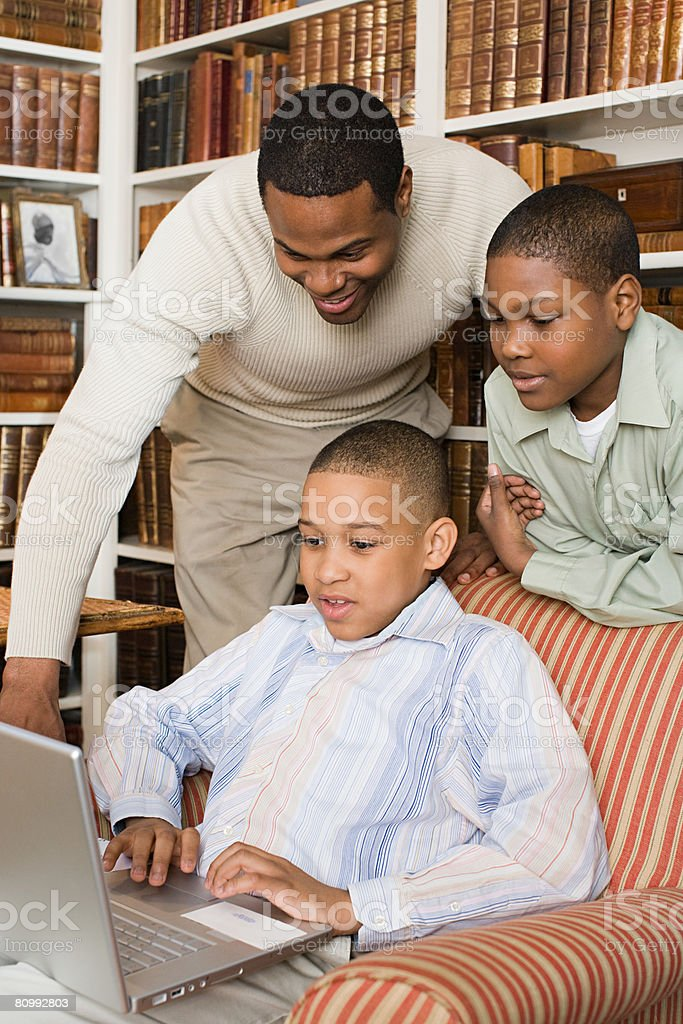 Father and sons looking at laptop royalty-free 스톡 사진