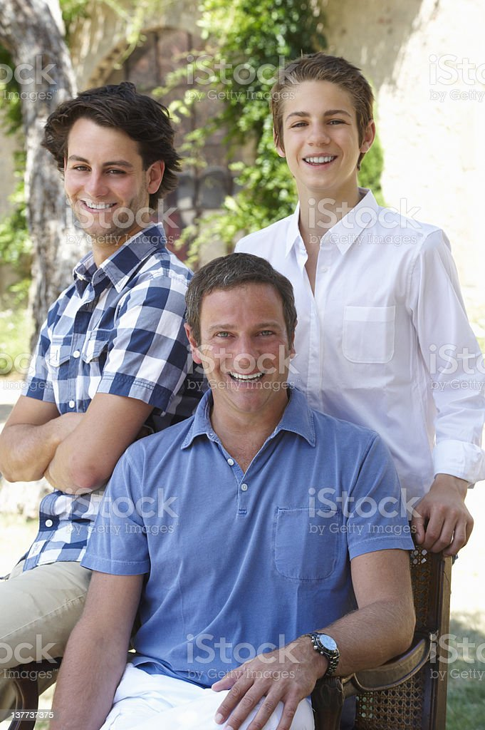 Father and sons smiling together royalty-free stock photo