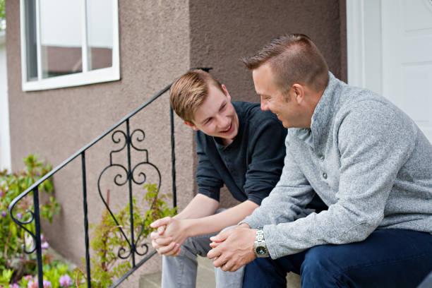 Father and Teen Son Bond stock photo