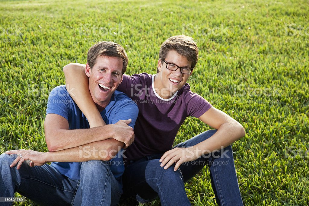 Father and teenage son stock photo